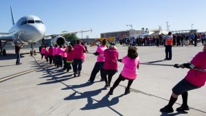 American Airlines employees pull 92,500-pound plane for charity